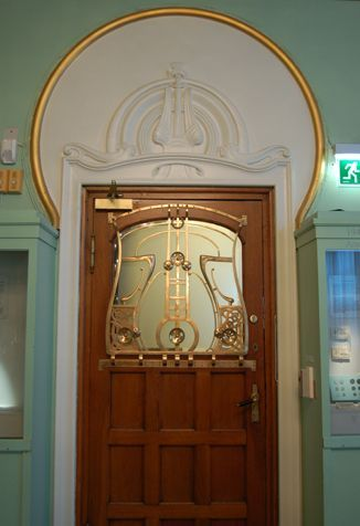 Door from the Coin Cabinet into the offices. The metalwork features typical Jugendstil ornamentation inspired by Norse forms and probably the Museum's own archaeological Collections.