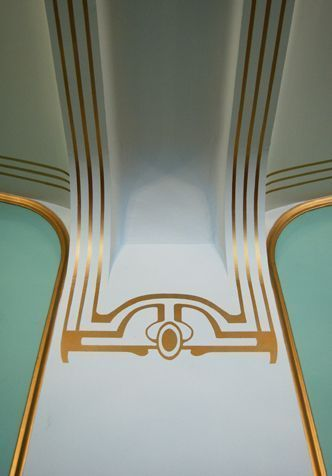Gold stencils and painted stripes, The Coin Cabinet. It is clearly inspired by Vienna's Art Nouveau movement.