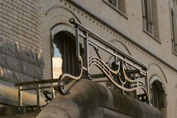 Even the staff entrance at the back of the building has wrought iron railings inspired by national forms.