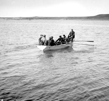 "Apart from a handful of Samoyed colonies, Novaya Zemlya was uninhabited, meaning there were no ports. The members of the expedition therefore had to row ashore from the ""Blaafjell"" to be able to do their research. Here they are going ashore at the Pankratyeff Peninsula."