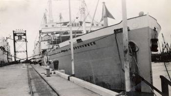 "They set off from Sandefjord, the centre of the Norwegian whaling industry, and sailed to Cape Town in two groups on the floating factory ships ""Solglimt"" and ""Thorshammer"". This photo is not from the day of departure – the ship was too large to dock in Sandefjord."