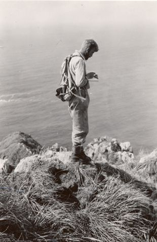 The expedition's natural scientists travelled to the island Nightingale. This photograph shows the geologist Dunne taking notes on top of the island.