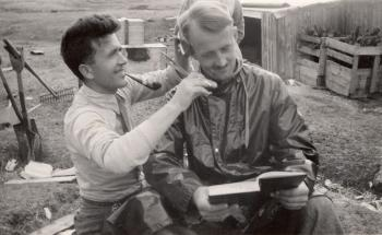 Time to spruce up a bit! Eggesvik cutting Sivertsen's hair. Soon time to head home, perhaps?